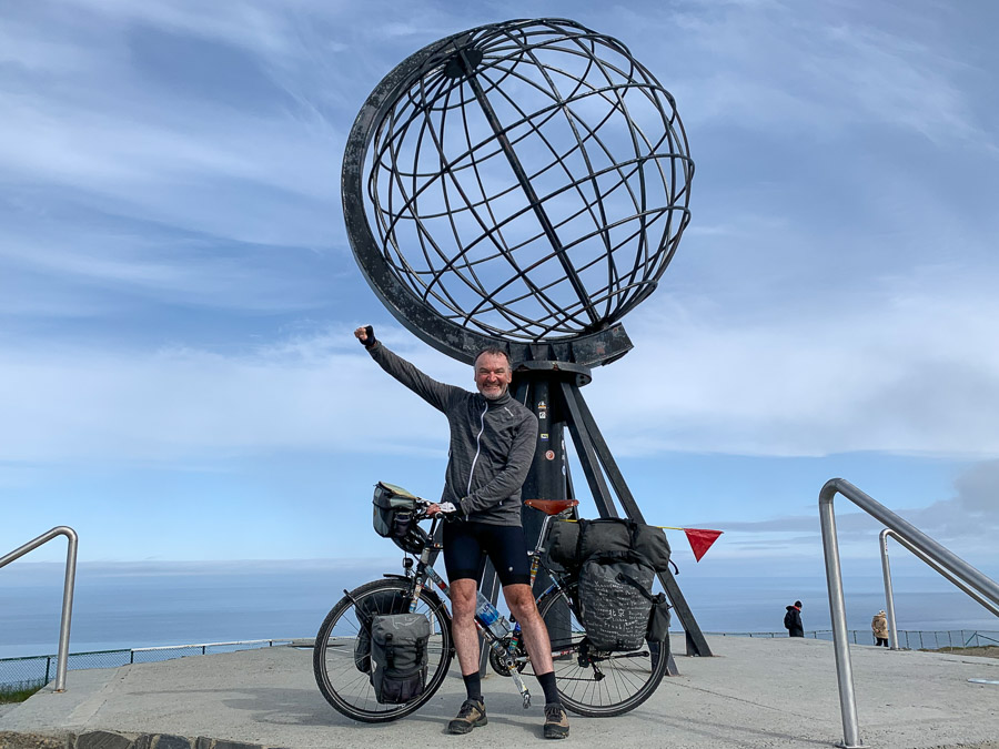 Klaus with bicycle next to a big globe